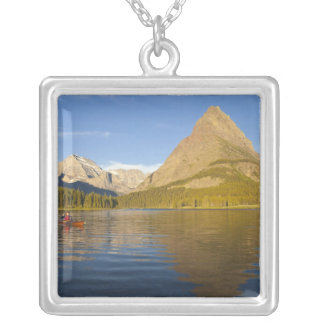 Kayaking in Swiftcurrent Lake at sunrise in the Square Pendant Necklace