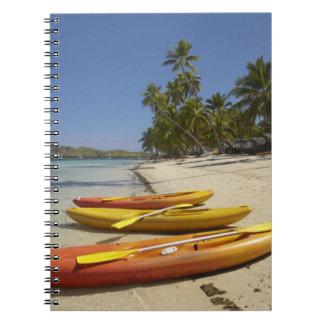 Kayaks on the beach, Plantation Island Resort Spiral Notebook