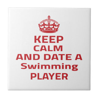 Keep calm and date a Swimming player Ceramic Tile