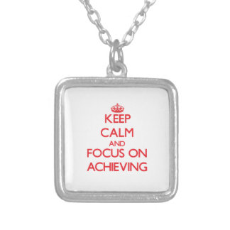 Keep calm and focus on ACHIEVING Pendants