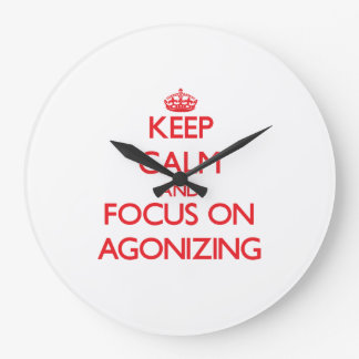 Keep calm and focus on AGONIZING Wall Clocks