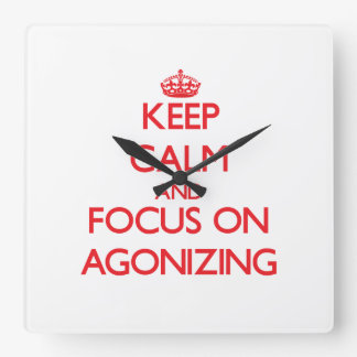 Keep calm and focus on AGONIZING Wallclock