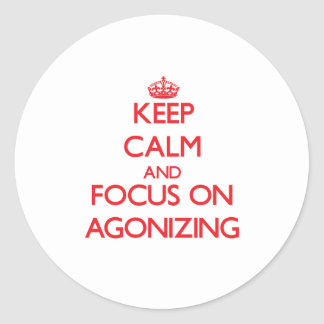 Keep calm and focus on AGONIZING Sticker