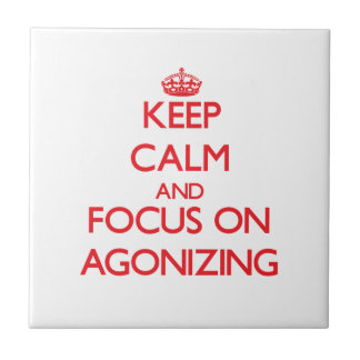 Keep calm and focus on AGONIZING Ceramic Tiles
