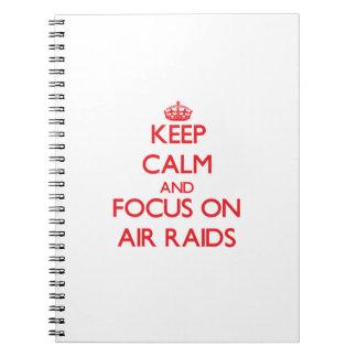 Keep calm and focus on AIR RAIDS Spiral Note Book