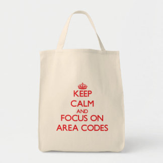 Keep calm and focus on AREA CODES Tote Bags