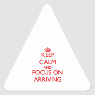 Keep calm and focus on ARRIVING Triangle Sticker