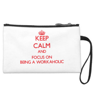 Keep Calm and focus on Being A Workaholic Wristlet Clutches