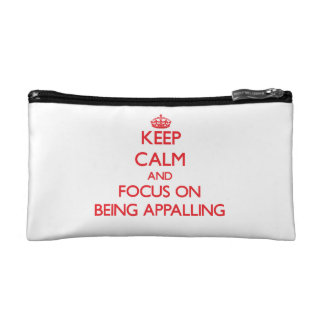Keep calm and focus on BEING APPALLING Cosmetics Bags