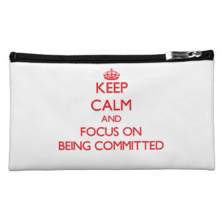 Keep Calm and focus on Being Committed Cosmetic Bags