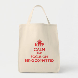 Keep Calm and focus on Being Committed Canvas Bags