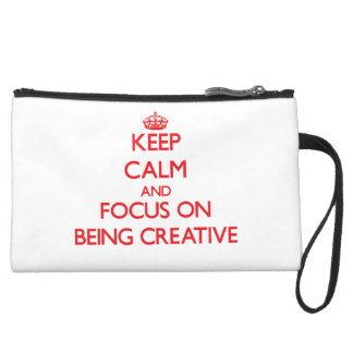 Keep Calm and focus on Being Creative Wristlet