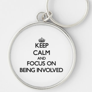 Keep Calm and focus on Being Involved Keychains