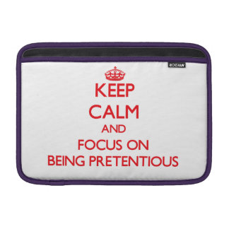 Keep Calm and focus on Being Pretentious MacBook Sleeves