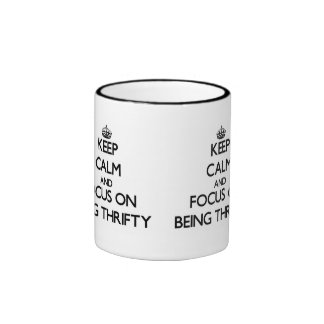Keep Calm and focus on Being Thrifty Coffee Mugs