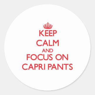 Keep Calm and focus on Capri Pants Round Sticker