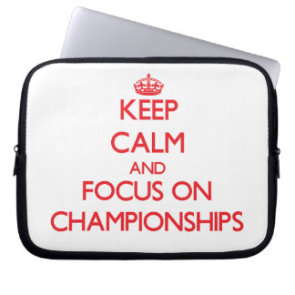 Keep Calm and focus on Championships Laptop Sleeves