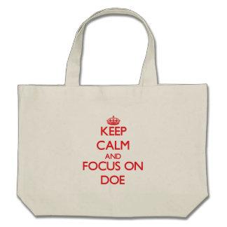 Keep Calm and focus on Doe Canvas Bags