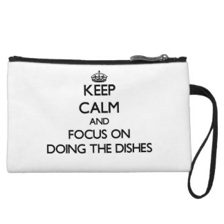 Keep Calm and focus on Doing The Dishes Wristlet Clutches