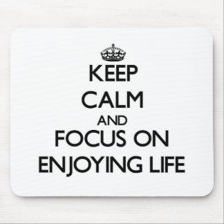 Keep Calm and focus on ENJOYING LIFE Mousepads