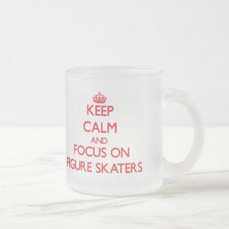 Keep Calm and focus on Figure Skaters Mugs