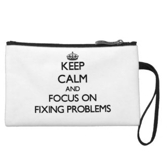 Keep Calm and focus on Fixing Problems Wristlet Purses