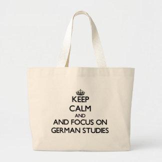 Keep calm and focus on German Studies Tote Bags