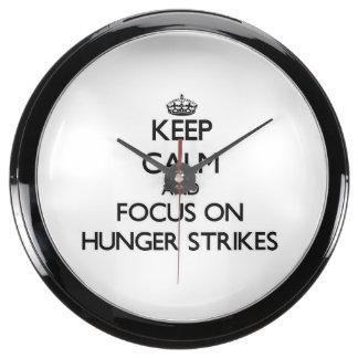 Keep Calm and focus on Hunger Strikes Aqua Clock