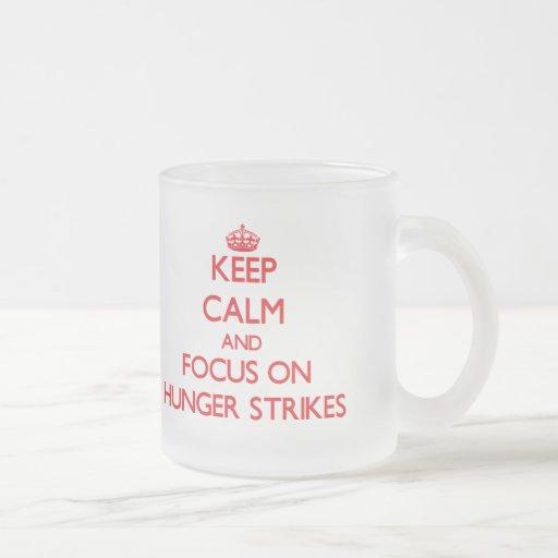 Keep Calm and focus on Hunger Strikes Coffee Mugs