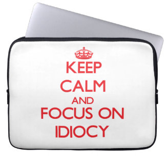 Keep Calm and focus on Idiocy Laptop Sleeves