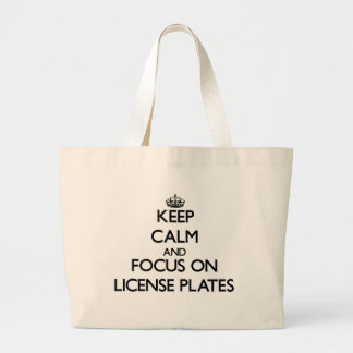 Keep Calm and focus on License Plates Canvas Bags