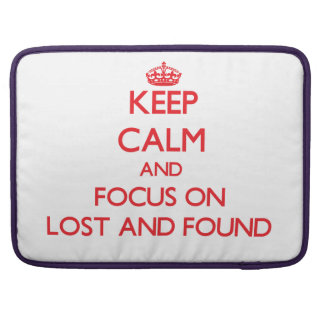 Keep Calm and focus on Lost And Found MacBook Pro Sleeves