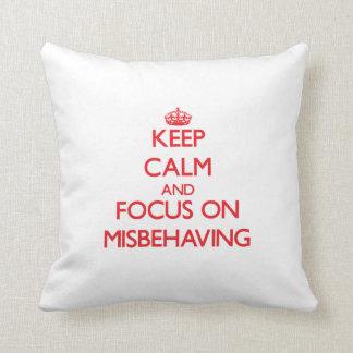 Keep Calm and focus on Misbehaving Throw Pillows