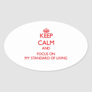 Keep Calm and focus on My Standard Of Living Oval Stickers