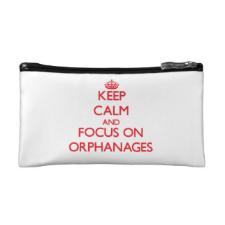 kEEP cALM AND FOCUS ON oRPHANAGES Makeup Bags