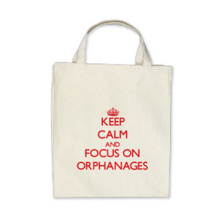 kEEP cALM AND FOCUS ON oRPHANAGES Tote Bags