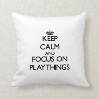Keep Calm and focus on Playthings Throw Pillow