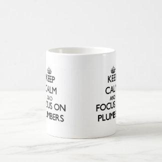 Keep Calm and focus on Plumbers Mug