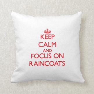 Keep Calm and focus on Raincoats Pillows
