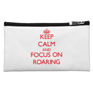 Keep Calm and focus on Roaring Makeup Bags