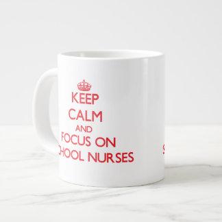 Keep Calm and focus on School Nurses Extra Large Mugs