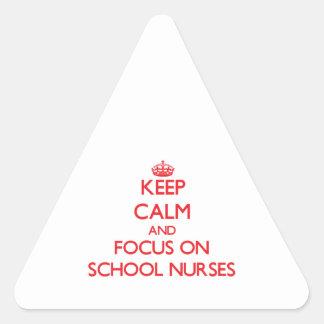 Keep Calm and focus on School Nurses Triangle Sticker