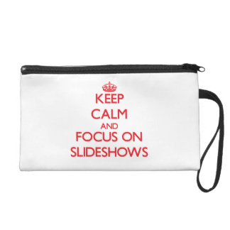 Keep Calm and focus on Slideshows Wristlet Clutches