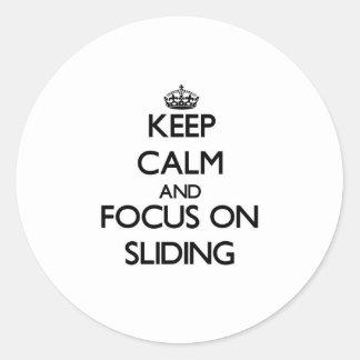 Keep Calm and focus on Sliding Round Sticker
