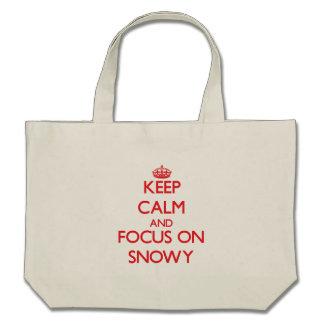 Keep Calm and focus on Snowy Canvas Bags