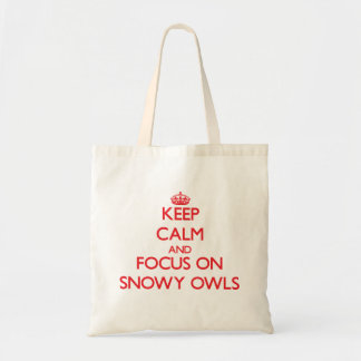Keep calm and focus on Snowy Owls Tote Bags