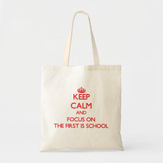 Keep Calm and focus on The First Is School Tote Bags