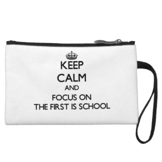 Keep Calm and focus on The First Is School Wristlet Purse