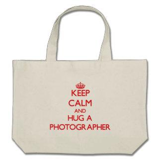 Keep Calm and Hug a Photographer Canvas Bags