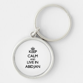 Keep Calm and live in Abidjan Keychains